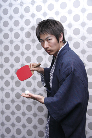 Mid adult man playing table tennis