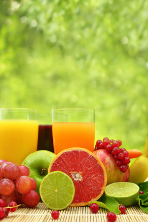 Fresh fruit and three glasses full of juice