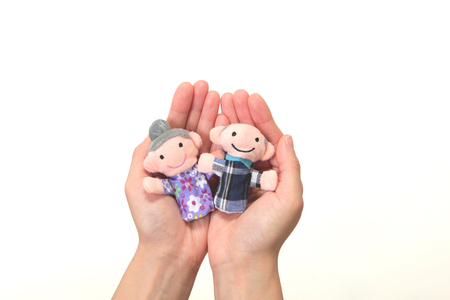 Puppet of the old couple in the handnursing care