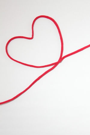 Red heart string, on white background 写真素材
