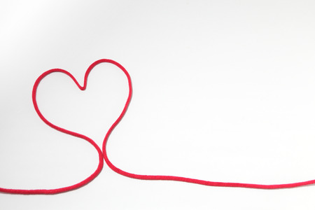 Red heart string, on white background Stock Photo