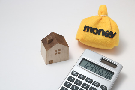 House and money House and money beside calculator
