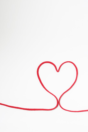 heartshaped: Heart-shaped red thong on white background