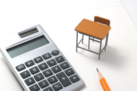 Notebook, calculator, pencil and miniature desk on white background.