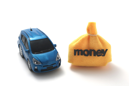 Car and money on white background.