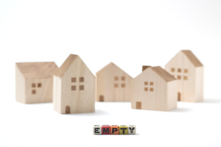 vacant: Residential vacant. There are the alphabet blocks, letters written with empty in front of miniature wooden houses.