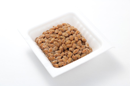 Natto, fermented soybeans on white background.