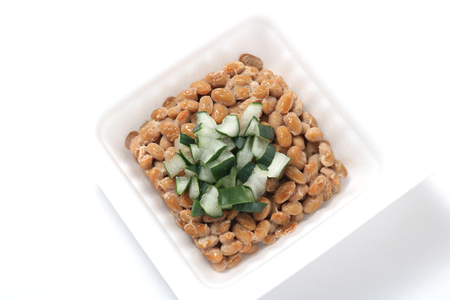 fermented: Natto, fermented soybeans with welsh onion on white background. Stock Photo