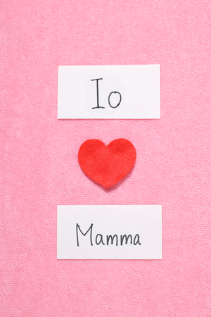 hand written: I Love Mom concept in Italian. Red heart and hand written letters spelling I Love mom concept in Italian. Stock Photo