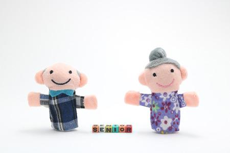 Doll of old couple with alphabet blocks that spell senior... Foto de archivo