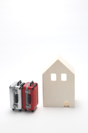 rentals: House and suitcases on white background. Vacation rentals, renting private homes and rooms.