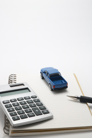 mail order: Toy car truck, calculator, notebook, and pen.