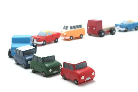 congestion: Miniature toy cars on white background. Traffic congestion.