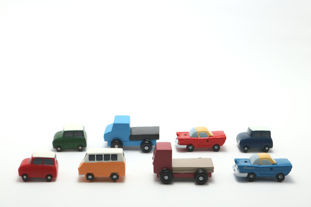 Miniature toy cars on white background. Traffic congestion.