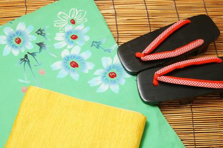 Concept of Japanese summer. Japanese yukata, obi, and sandals.