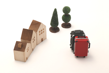 Houses and suitcases on white background. Vacation rentals, renting private homes and rooms. Stock Photo