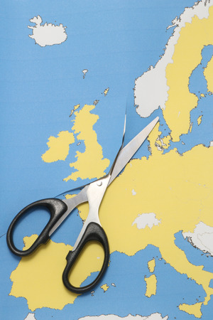 United Kingdom leaves the European Union. Scissors cut the United Kingdom from EU. Brexit UK EU referendum concept.