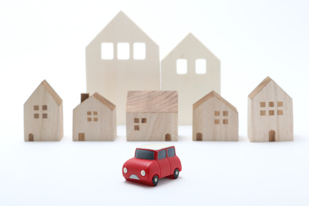 white back ground: Miniature car and houses on white back ground.
