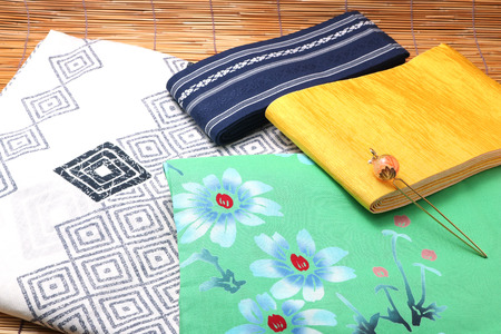 Japanese yukata and a band for men and women on bamboo blinds. Concept of Japanese summer.
