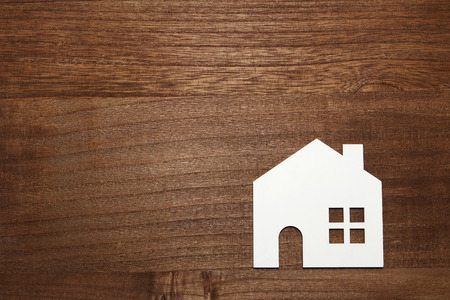 Miniature white house on wood. New house concept. Stock Photo