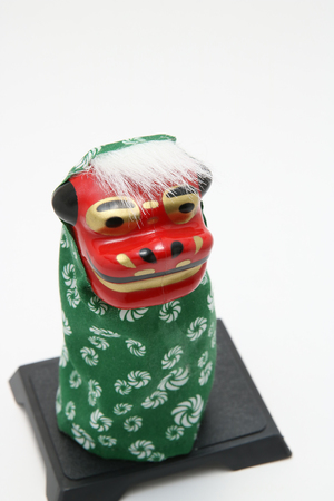 New Year decorations of traditional lion dance (Shishimai) of Japan on white background. Stock Photo
