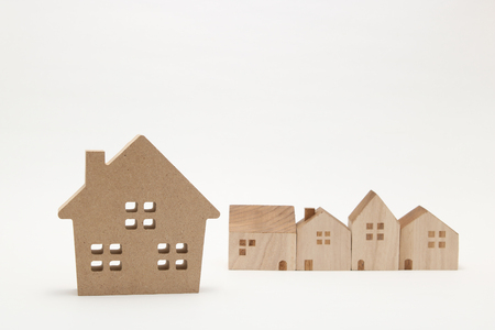 housing lot: Miniature houses on white background. Building blocks arranged in row.