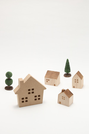 Miniature houses and trees on white background. Building blocks arranged.