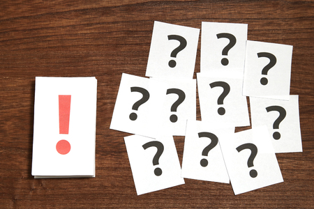 Exclamation mark in front of many question marks. The solution concept.