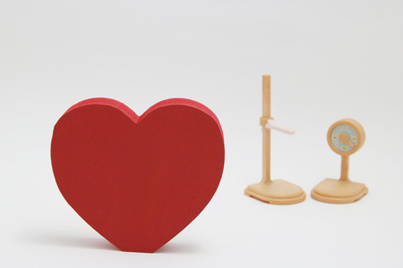 Heart mark, weight scale and height meter on white background. Medical checkup concept.