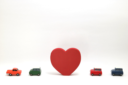 Some red hearts and cars on white background. Safe driving concept. Stok Fotoğraf