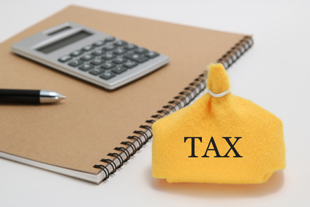 Money bag, caluculator, and notebook on white background. Tax concept. Stock Photo