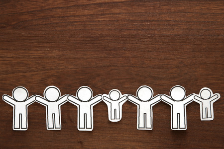 Group of people holding hands on wood. Teamwork concept. Social Network concept. Stock Photo