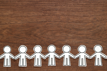 Group of people holding hands on wood. Teamwork concept. Social Network concept. Banque d'images