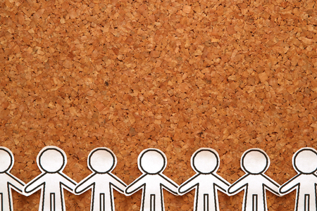 Group of people holding hands on bulletin board. Teamwork concept. Social Network concept.