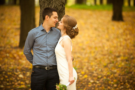 young man and woman on a walk in a city park, happiness, love, tenderness Stock Photo