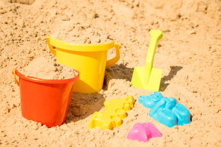 Fine river sand with toys for childrens sandboxes 스톡 콘텐츠