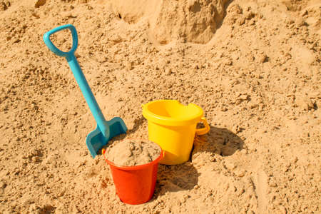 Fine river sand with toys for childrens sandboxes 免版税图像