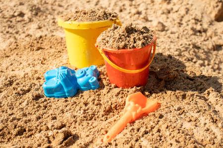 Fine wet river sand with toys for childrens sandboxes 免版税图像