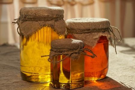 Jars of honey. Different types of honey. Honey jar. Natural raw honey
