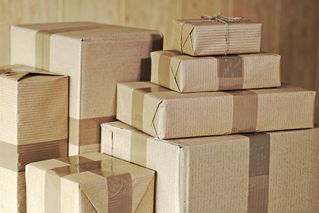 A stack of large and small postal parcels on the table