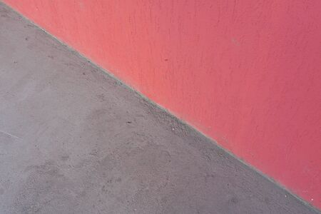 Pink wall and gray concrete floor, abstract background