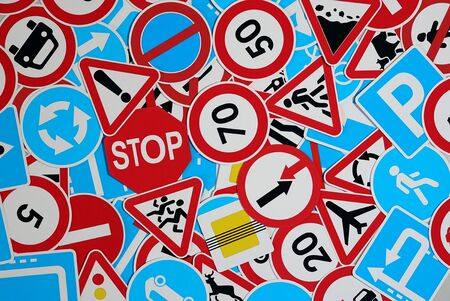 Road signs. Many american and european traffic signs mixed together