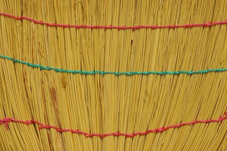 Broom from rods. Brush of  bound straw close up