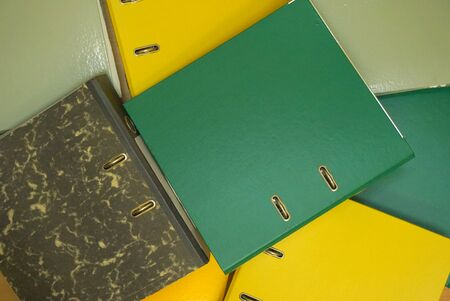 Multicolored stationery folders. Plastic folders with documents. Top view