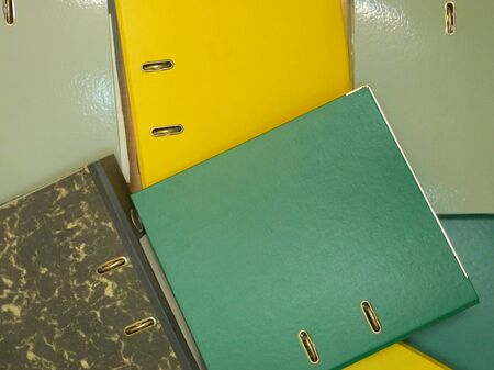 Plastic folders with documents. Multicolored stationery folders