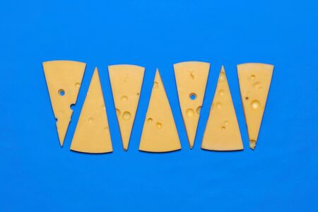 Hard Italian cheese a blue background. Top view 스톡 콘텐츠