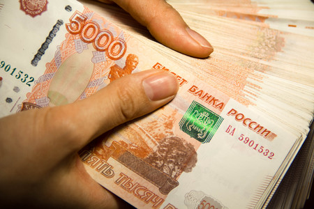 devaluation: Ruble Close-up  Money in a womans hand