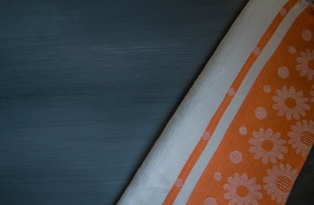 menue: orange tablecloth on wooden  black  table view from top cloth Stock Photo