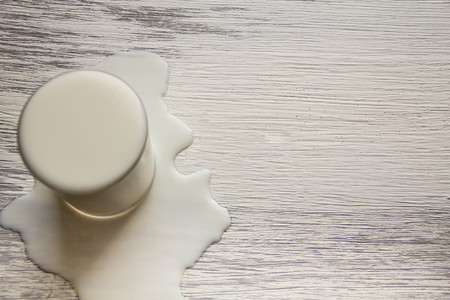 Jug and glass cup with almond milk on the wooden table. lactose free intolerance - food with wooden background