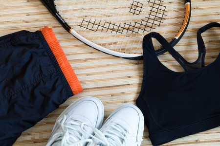 fitness accessories, sports shoes, clothing, dumbbell, headphones, tennis racket, mockup, text, note Archivio Fotografico